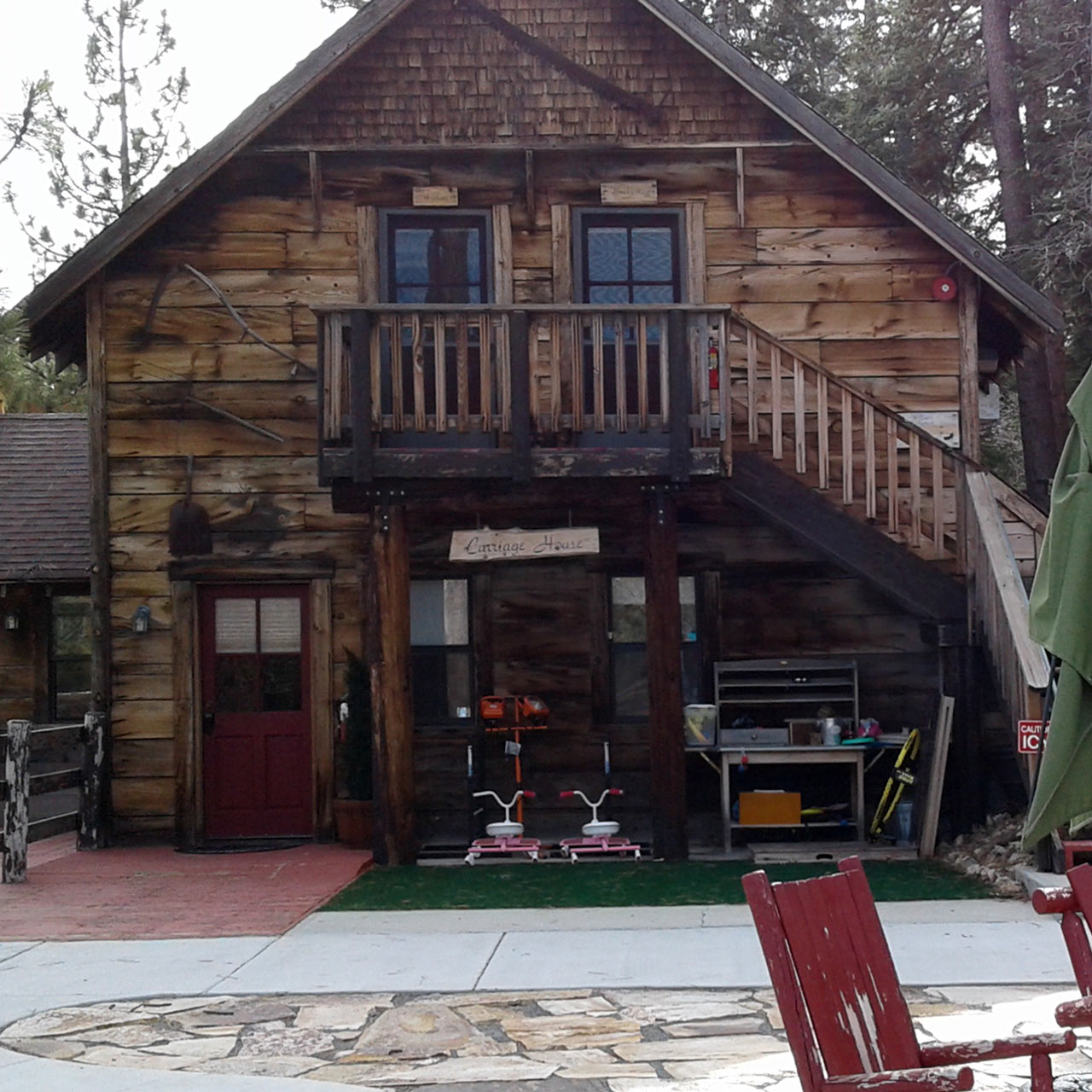 Carriage house with kids toys and other courtyard items