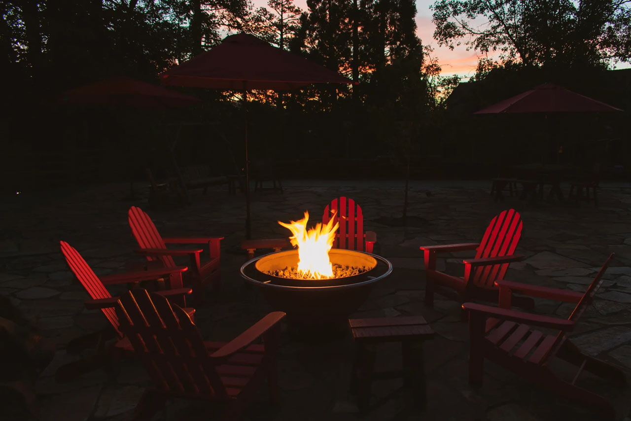 Warm seating around a fire ring with mountain views