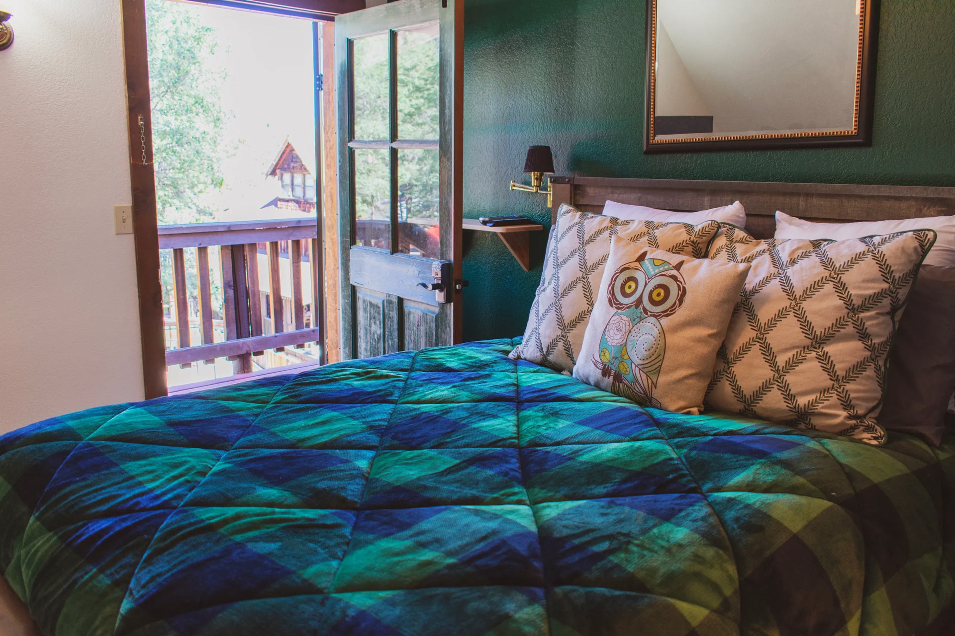Carriage house bedroom with balcony with a view of the forest