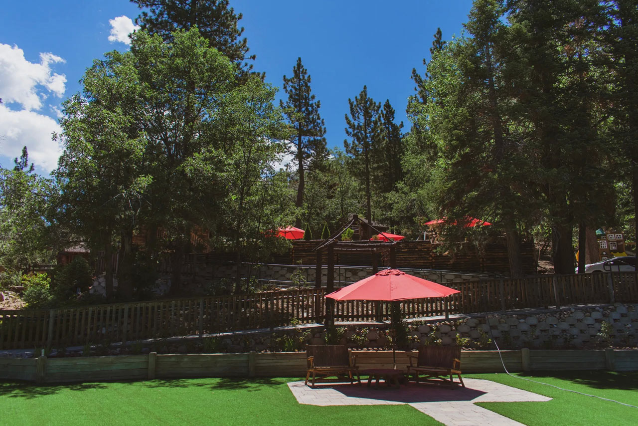 Shaded seating area with giant red umbrella