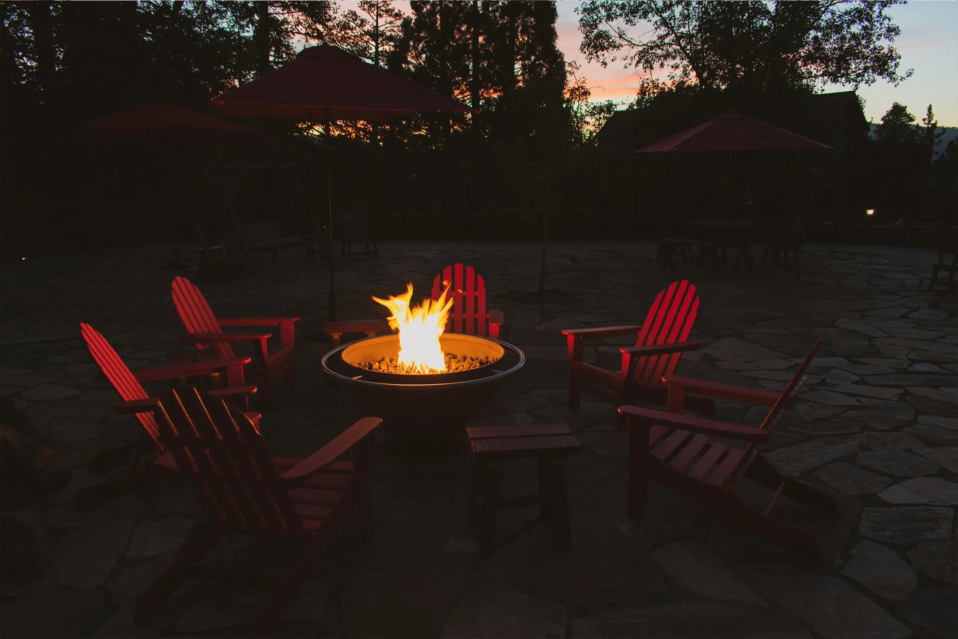 Fire pit in the courtyard with the sun setting