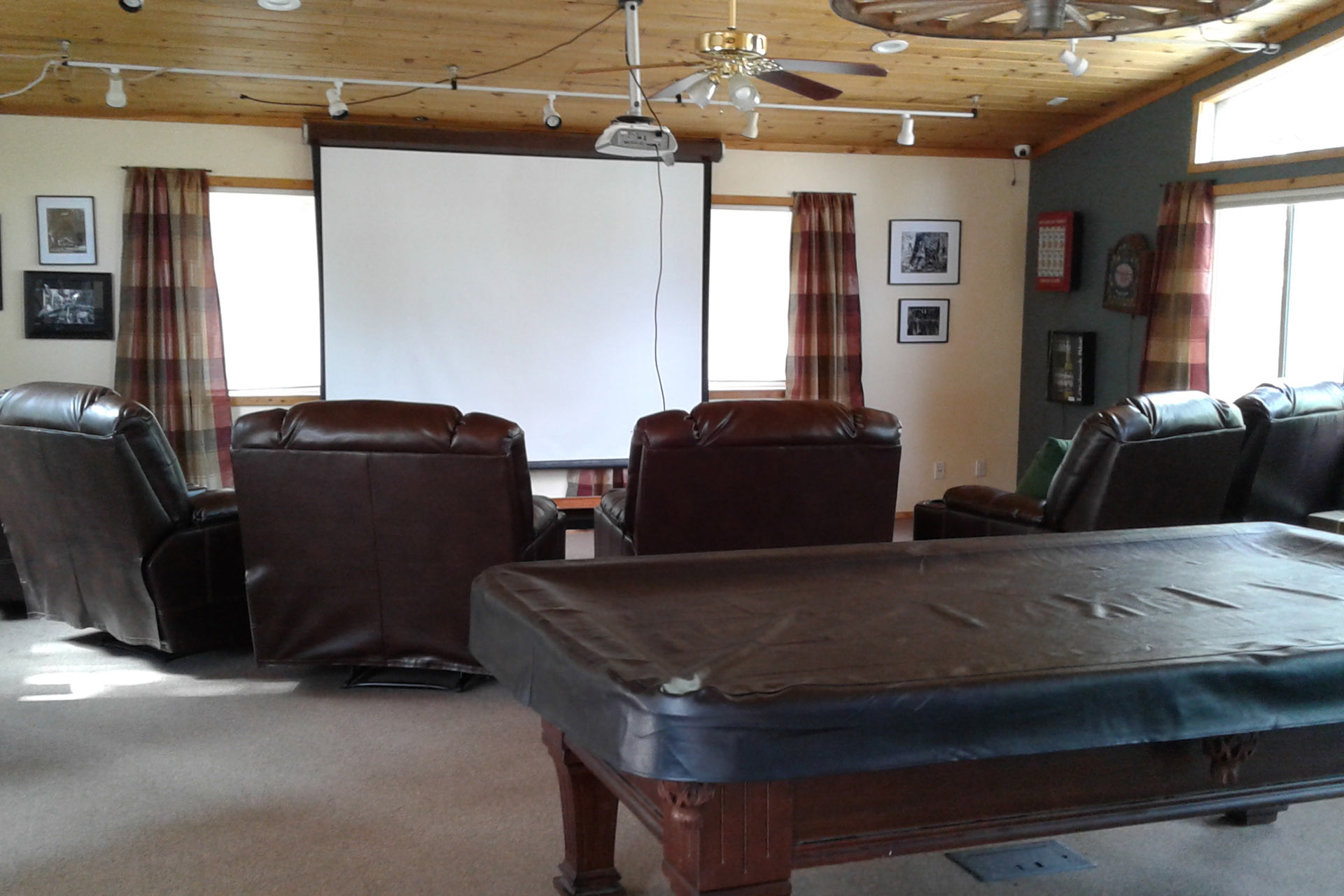 Pool table and Movie screen in the Knickerbocker Mansion Recreation room