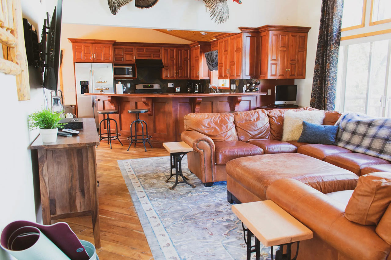 great living room with big flatscreen TV and kitchen access