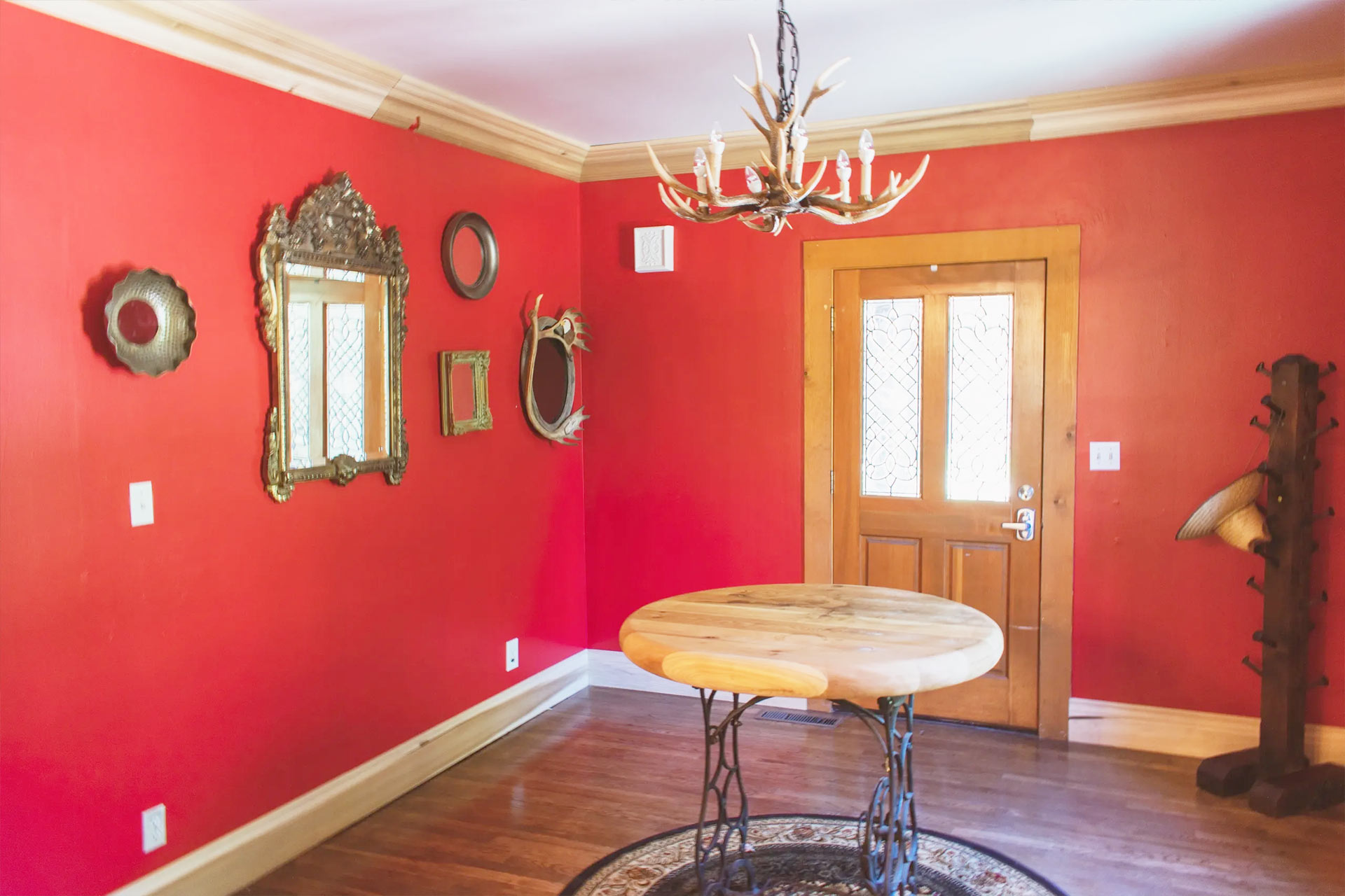 Bright red wall of the Knickerbocker mansion entry way