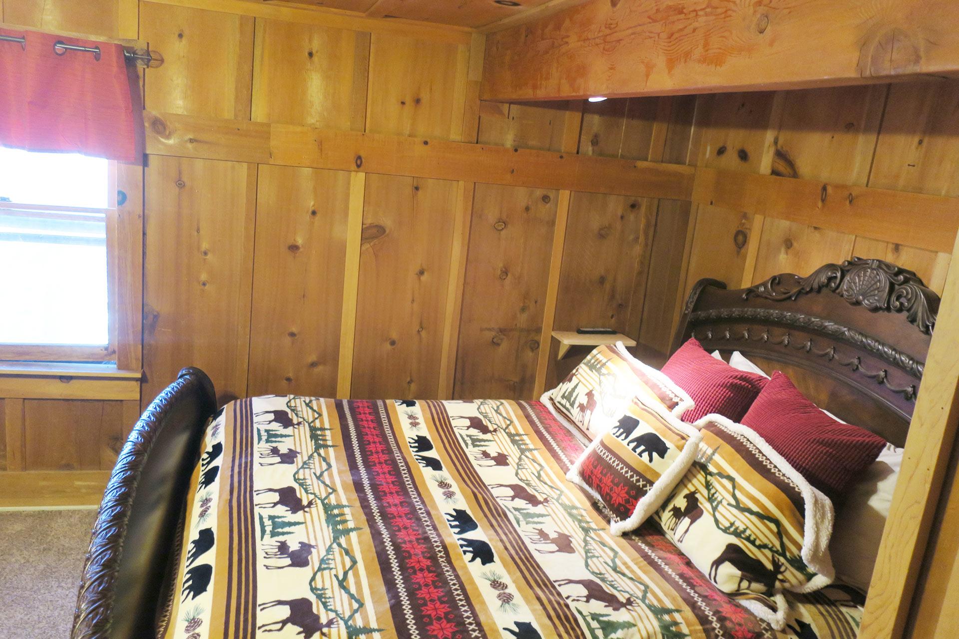 Master bedroom festive comforter in the knickerbocker mansion