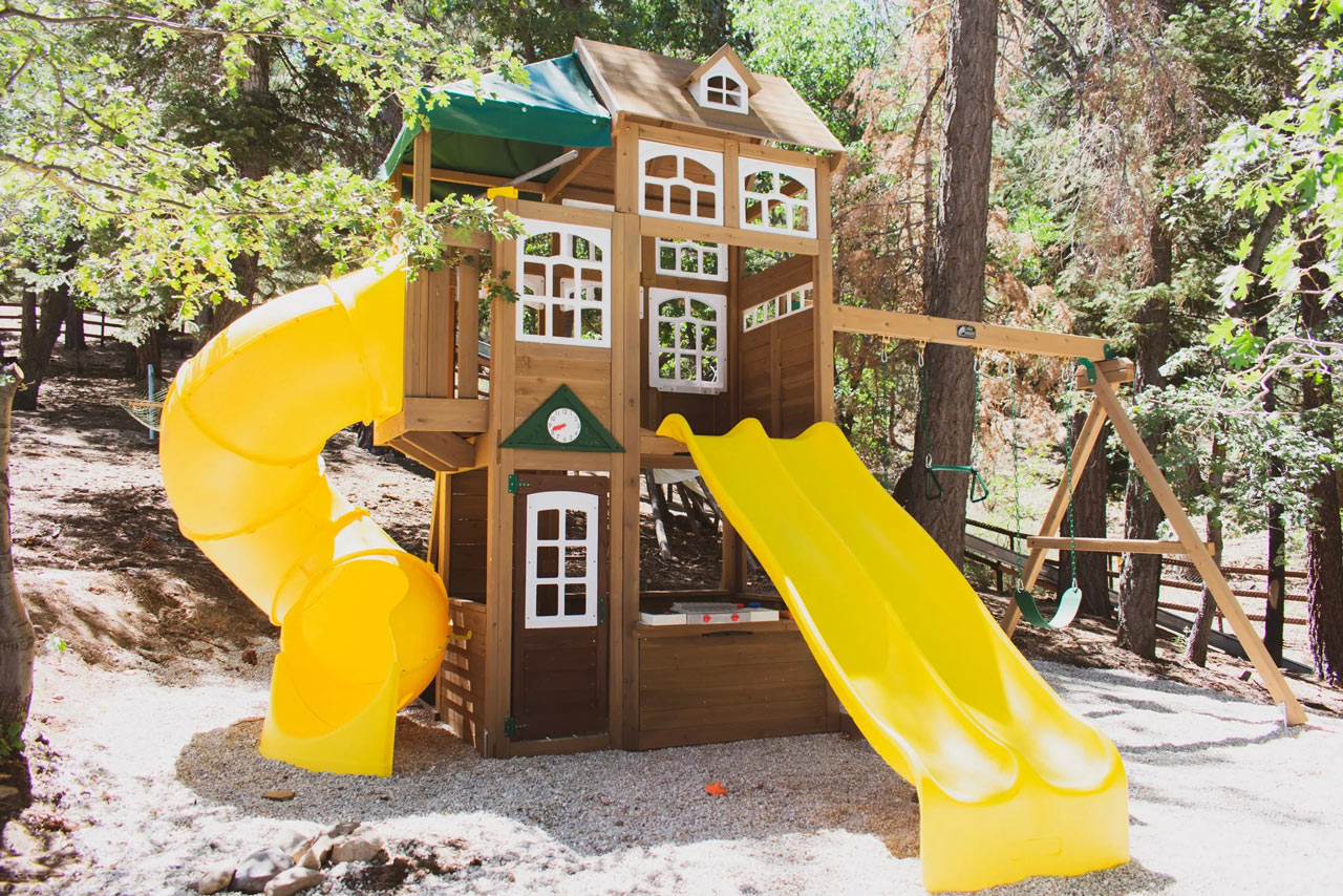 play house with slides and swings for the kids