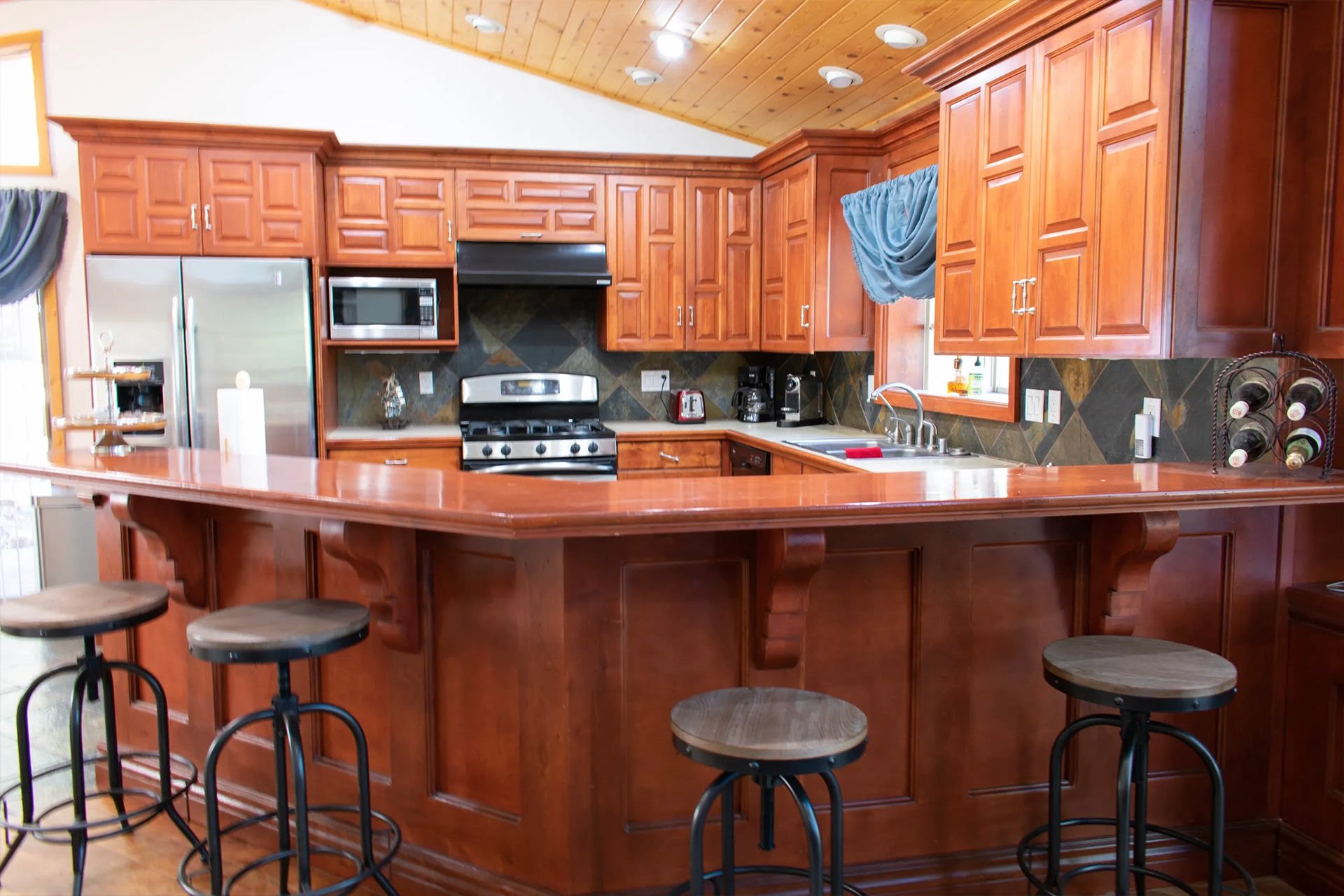 kitchen in the residence with bar-style seating