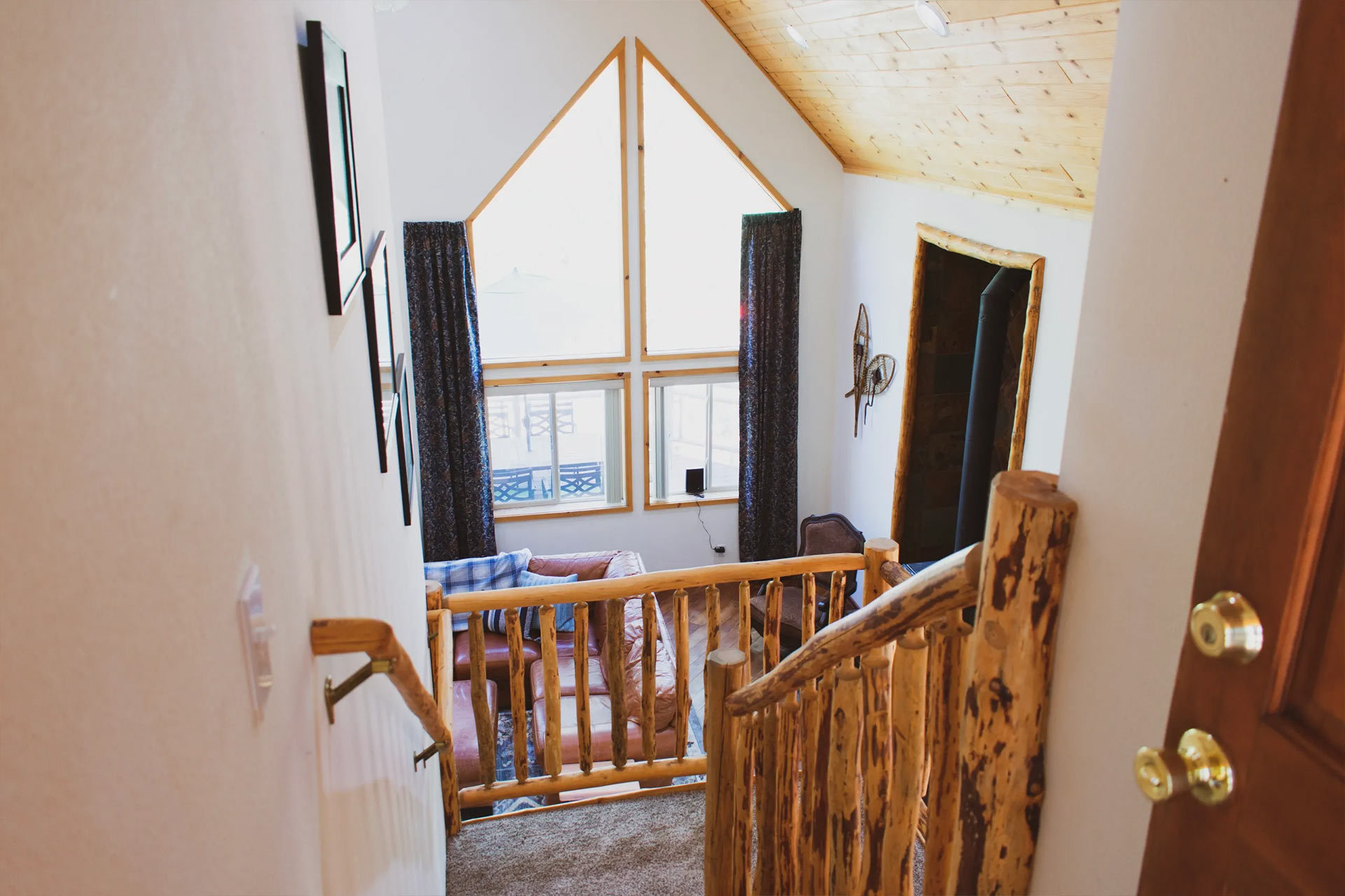 View from the top of the stairway down to the living room at the residence