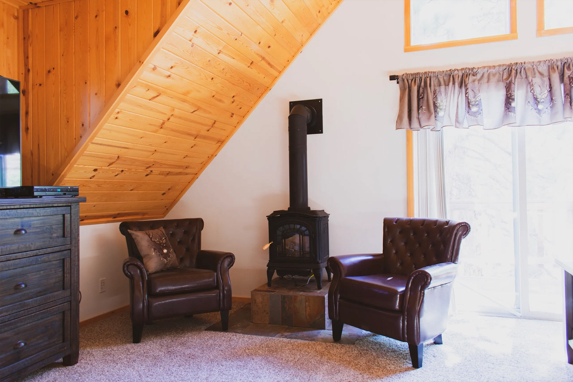 Master bedroom suite with cast iron stove at the residence