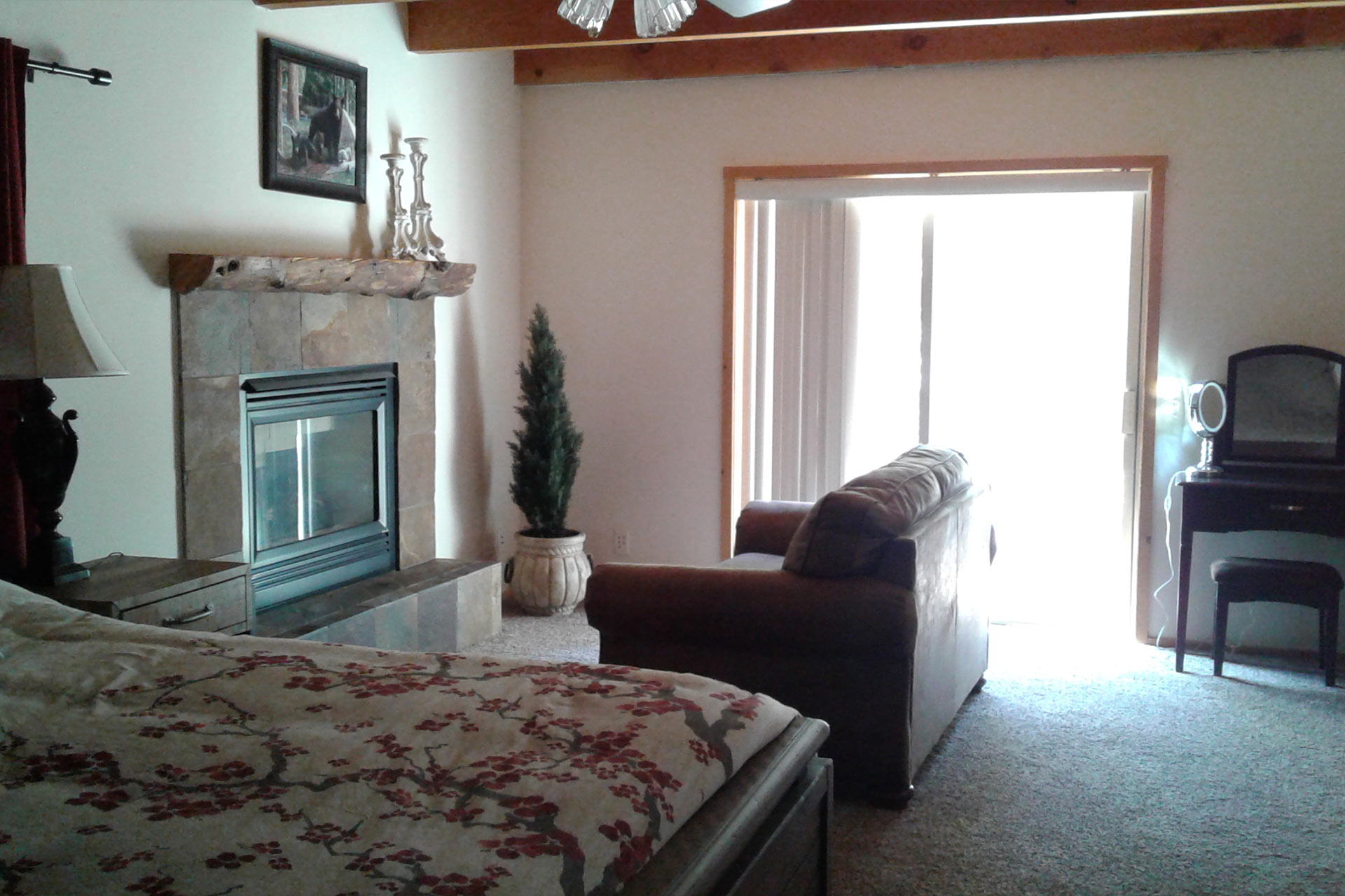 Master bedroom with fireplace at the residence